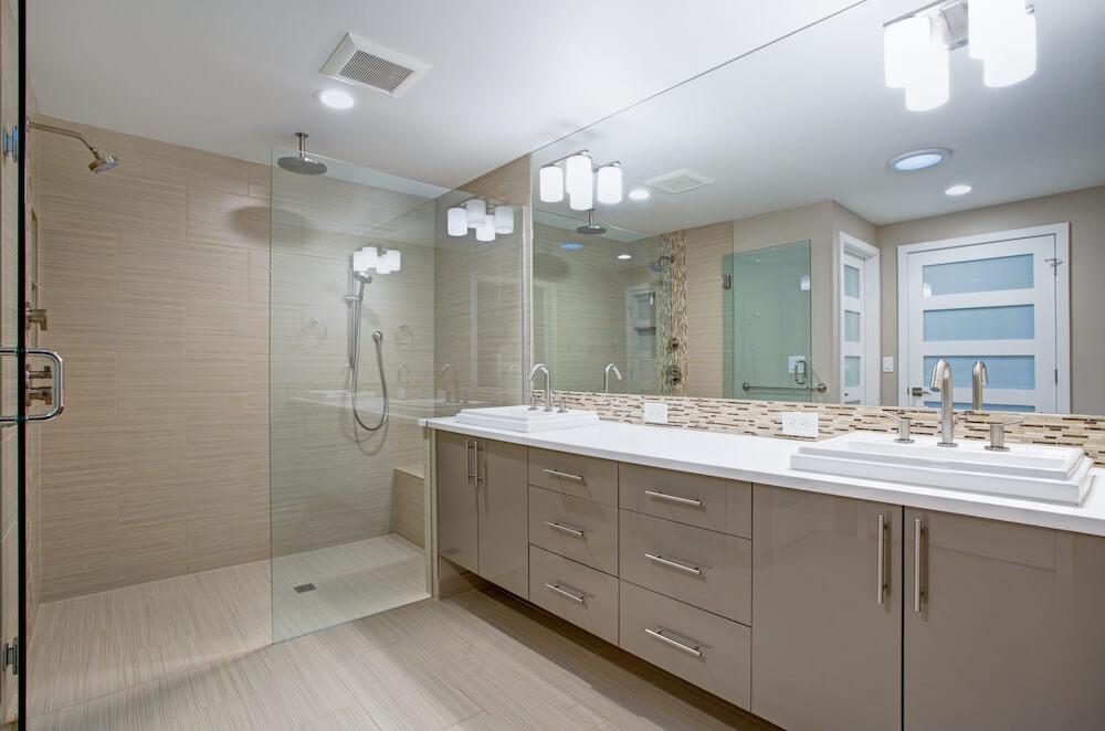 Frameless glass doors, Sink, Cabinets, Tile, Lighting