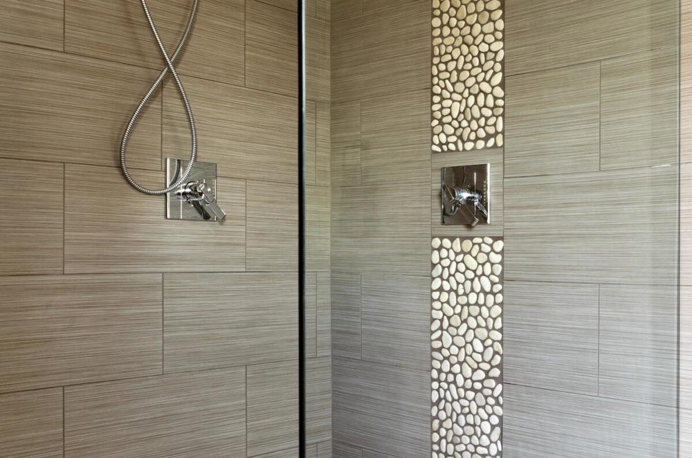 Bathroom Remodel Pebbled Waterfall, Black Grout Frameless glass Doors