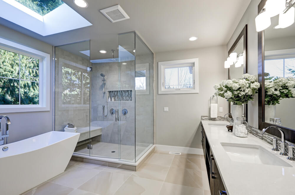 Bathroom with Glass Shower Enclosure, Tan Tile, White Marble Sink