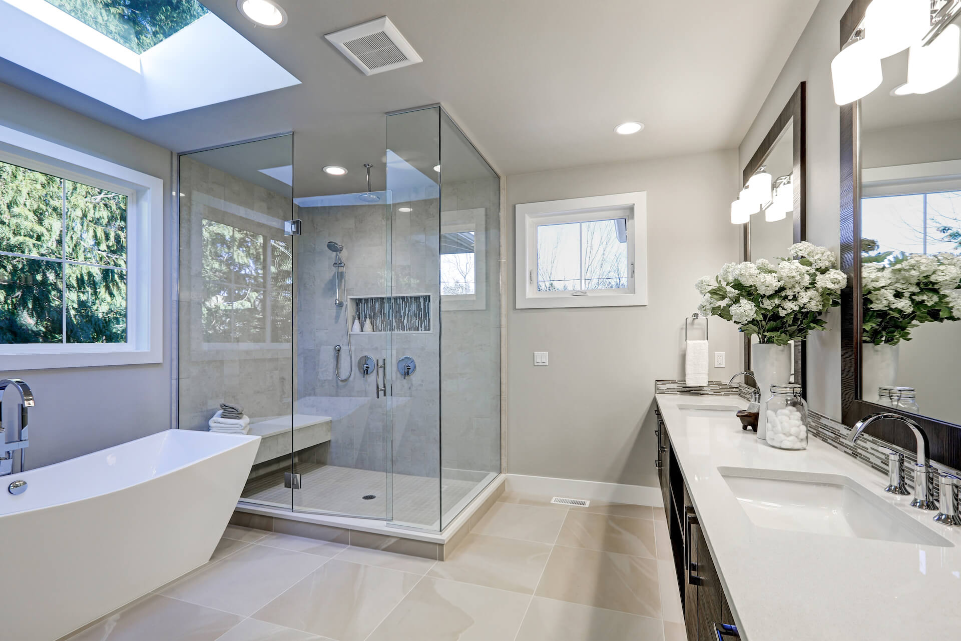 Bathroom Remodel with Frameless Glass Doors Chrome Fixtures Brown Cabinets