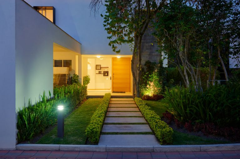 Landscape Remodel with Slab Walkway Trees, Shrubs, Pole Lights, Entry way