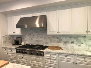 Cooking area with aluminum stove and hood