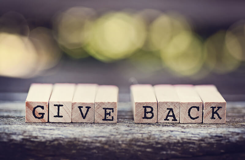 Give Back written on wooden blocks