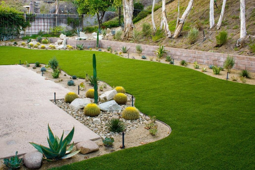 San Diego Landscape Remodel with stamped retaining wall hardscape feature and softscape with succulents