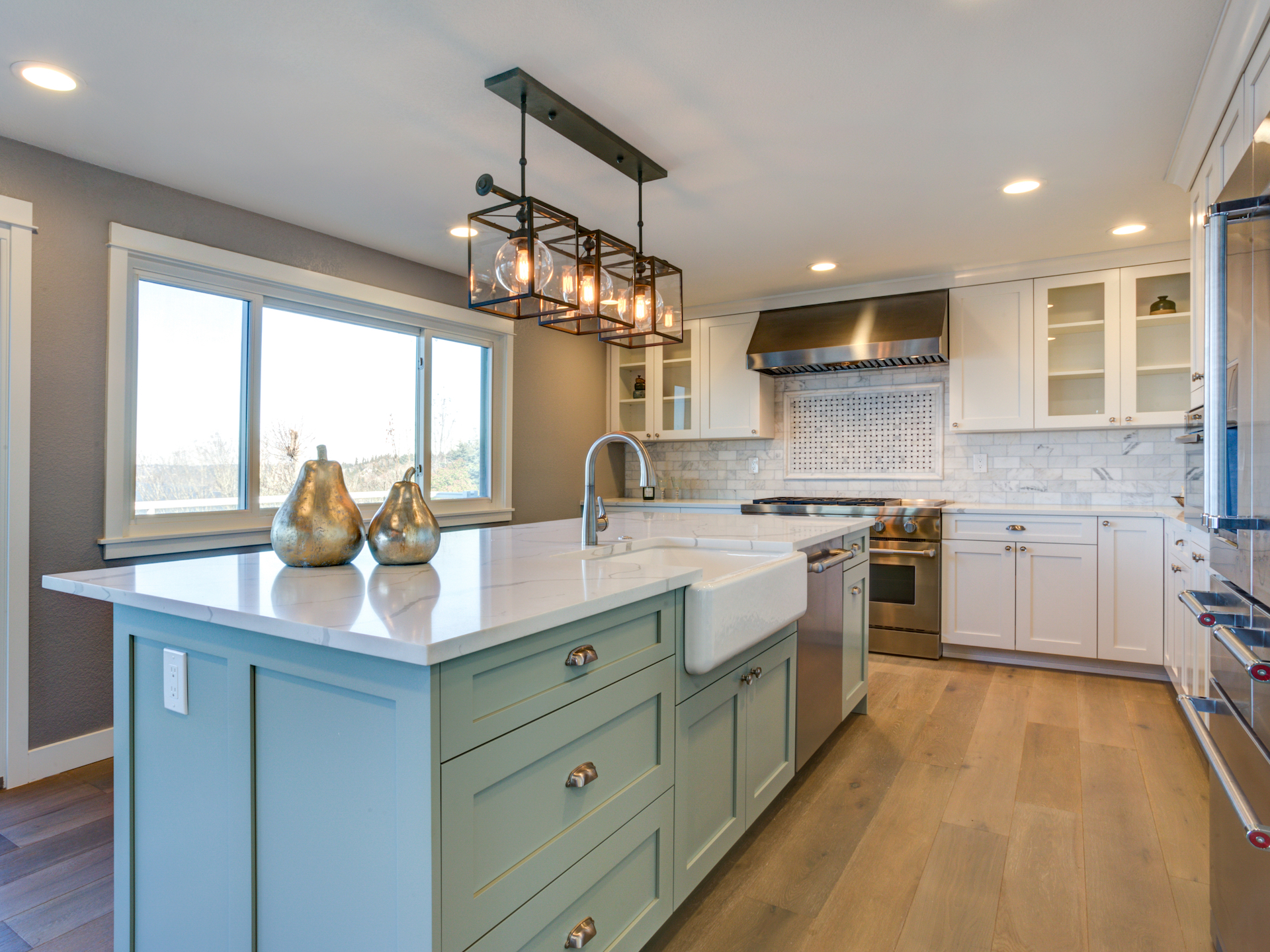 Lime green kitchen island with pendant lighting above