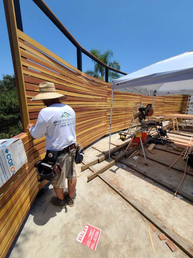 Horizontal Wacood Slat Fence Build In Progress in 92128