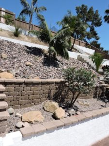 Embankment with stone and cinder block retaining walls