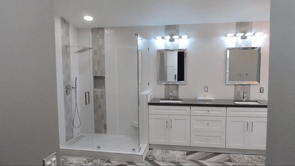Master Bathroom with Frameless Shower, Custom Vanity, Chevron Tile, Grey and White Color Scheme