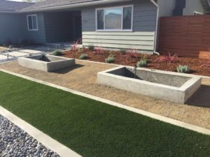 Artificial Turf, Cement Mow Strip, River Rock, Concrete Wall Planters, Concrete Pavers Path