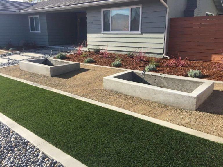 Artificial Turf, Cement Mow Strip, River Rock, Concrete Wall Planters, Concrete Pavers Path