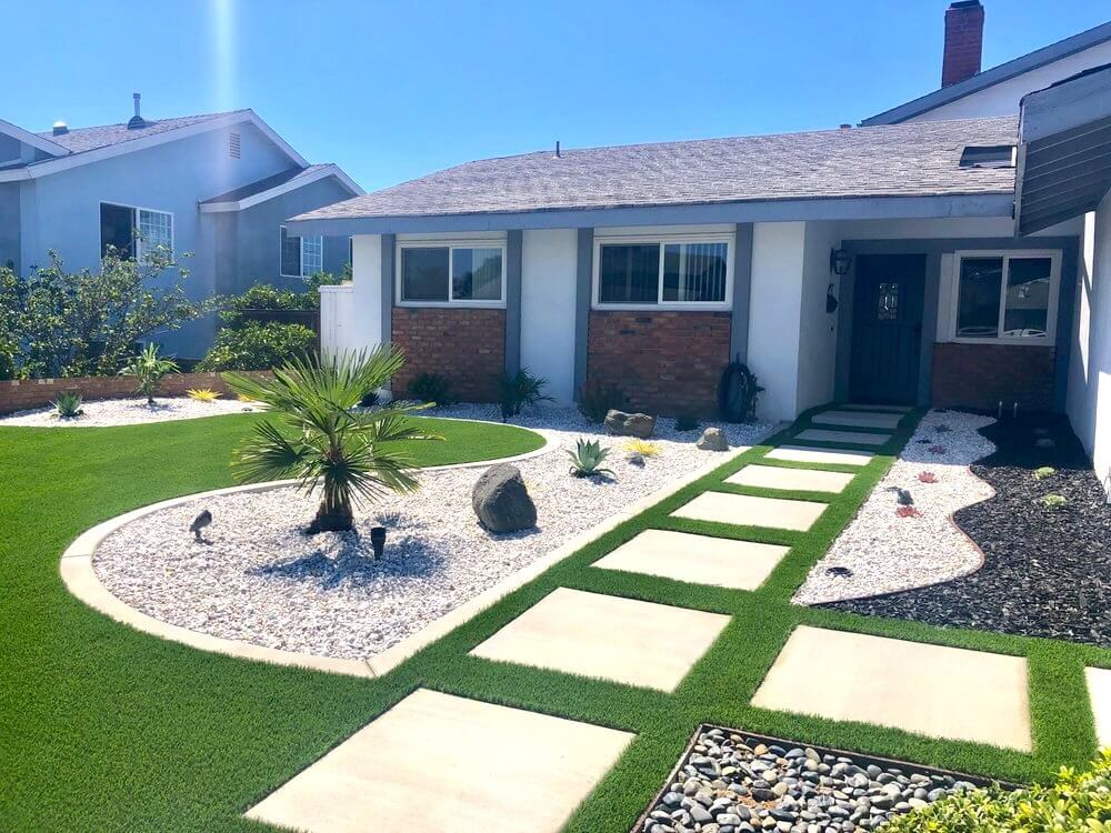 Front Yard with artificial turf, concrete pavers, rock ground cover, palm tree